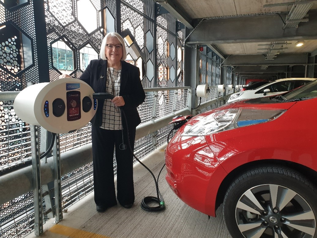 Cllr Judith Guthrie charging her electric car at Time Square