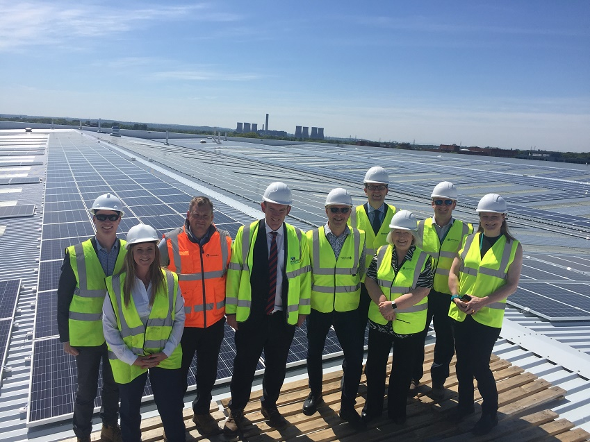 Councillors on the roof next to the solar panels