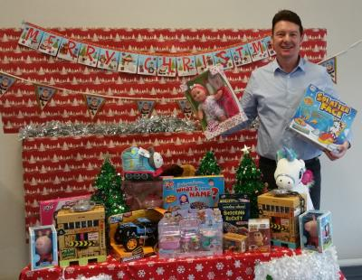 Cllr Tony Higgins with toy appeal donations